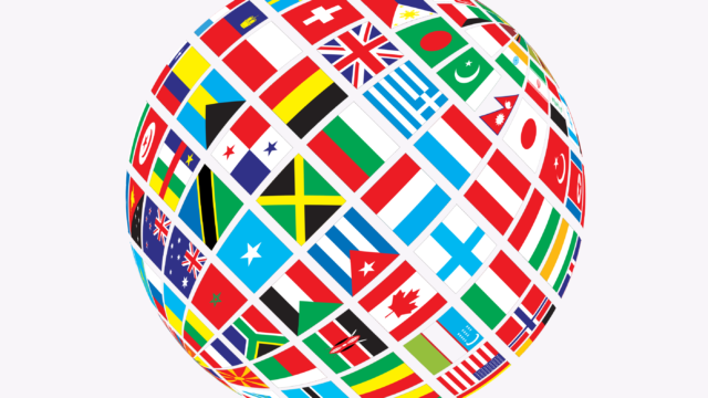 A globe comprising multiple, international flags.