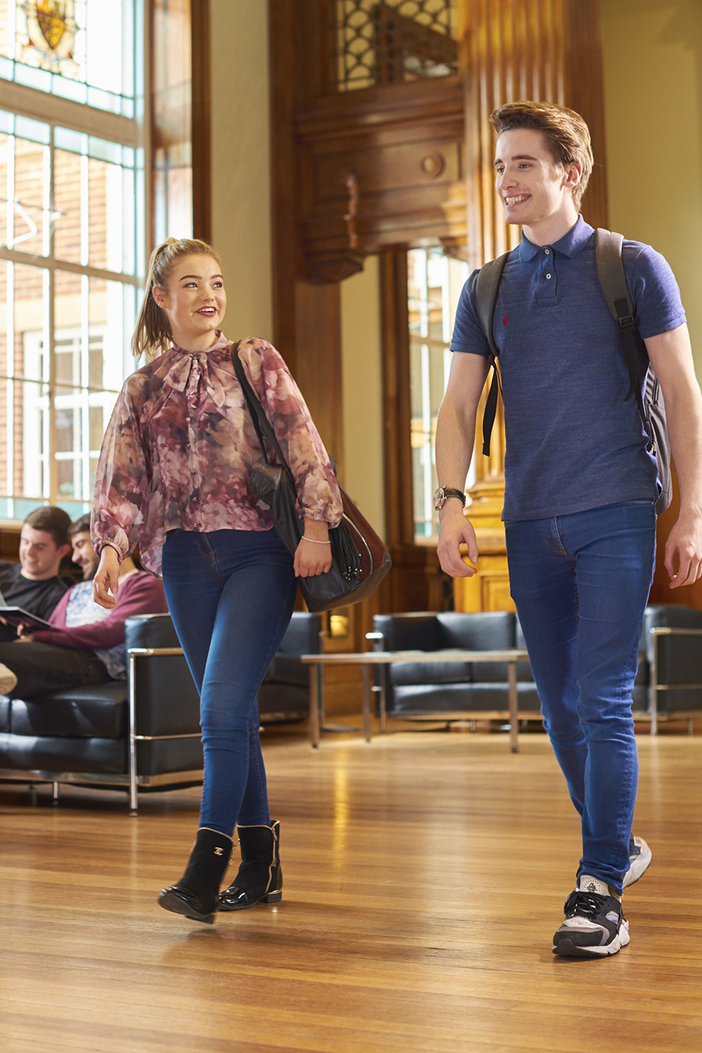 Two students walking through Hale Hall.