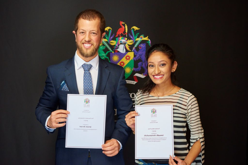 Scholarship winners Samadhi Hettiarachchi and Yotam Berant show their certificates at a Scholarship Awards Evening.
