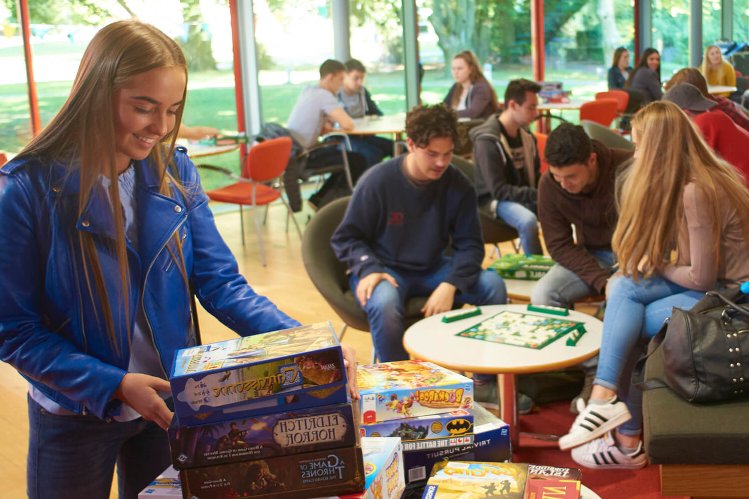 A student looks through the choice of board games at the Games Cafe, hosted in the Reds Bar in the Arts Centre.